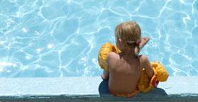 Child Sitting on Swimming Pool Edge