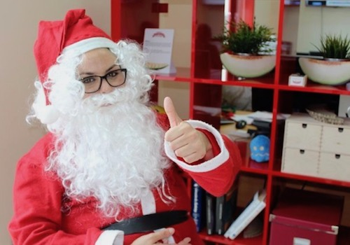 Santa sitting on a Chair Giving the Thumbs-up