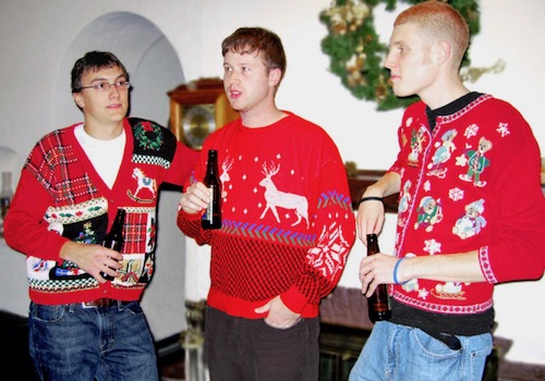 Three Guys in Ugly Red Christmas Sweaters Standing around Drinking Beer